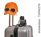 suitcase with objects for tour | Shutterstock . vector #719942170