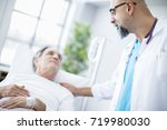 doctor talking to patient in... | Shutterstock . vector #719980030