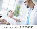 doctor talking to patient in... | Shutterstock . vector #719980030