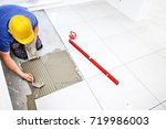 laying tiles at home.... | Shutterstock . vector #719986003