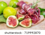 Small photo of Ripe fig fruits and bacon or prosciutto. Food to accompany the drinks.