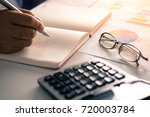 hand woman doing finances and... | Shutterstock . vector #720003784