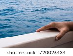 close up of person on deck of... | Shutterstock . vector #720026434