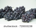bunches of fresh ripe blue wine ... | Shutterstock . vector #720033238
