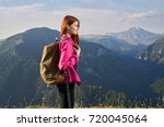 hiking in the mountains  young... | Shutterstock . vector #720045064