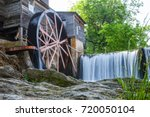 old mill on river in pigeon... | Shutterstock . vector #720050104