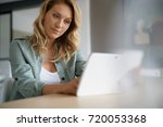 woman sitting at home websufing ... | Shutterstock . vector #720053368