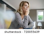 attractive middle aged blond... | Shutterstock . vector #720055639