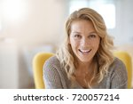 Small photo of Portrait of beautiful 40-year-old blond woman