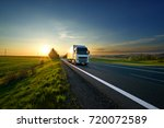 white truck driving on the... | Shutterstock . vector #720072589
