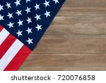 the american flag on a wooden... | Shutterstock . vector #720076858