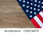 the american flag on a wooden... | Shutterstock . vector #720076870