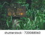 direction sign in the woods | Shutterstock . vector #720088060