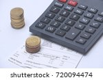 stack of coins  calculator and... | Shutterstock . vector #720094474