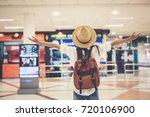 happy woman tourist atin the... | Shutterstock . vector #720106900