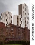 Small photo of September 2017 - a contrast view of old warehouses and modern towers in Manchester, UK, which was the first industrial city in 19th century and undergone extensive redevelopment in recent years