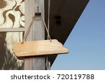 hanging wooden blank sign on a... | Shutterstock . vector #720119788