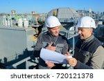 smiling workmen holding plans...   Shutterstock . vector #720121378