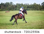 rider at cross country  | Shutterstock . vector #720125506
