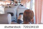 caucasian man traveling in a... | Shutterstock . vector #720134110