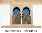 Reflection in Alhambra windows - stock photo