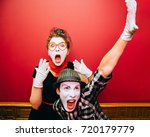two mimes showing emotions on... | Shutterstock . vector #720179779