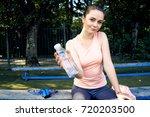 beautiful fitness athlete woman ...   Shutterstock . vector #720203500