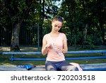 beautiful fitness athlete woman ...   Shutterstock . vector #720203518