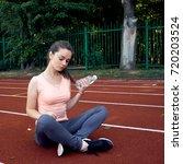 beautiful fitness athlete woman ...   Shutterstock . vector #720203524