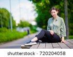 girl caucasian drinking hot...   Shutterstock . vector #720204058