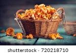raw wild chanterelles mushrooms ... | Shutterstock . vector #720218710