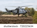 military helicopter hovering