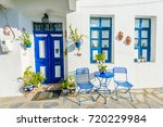 in front of a greek house  blue ...   Shutterstock . vector #720229984