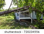 falling tree after hard storm... | Shutterstock . vector #720234556