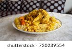 moroccan couscous with chicken | Shutterstock . vector #720239554