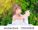 two years old lovely girl play...   Shutterstock . vector #720242818