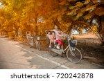 happy family riding bikes...   Shutterstock . vector #720242878