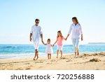 happy family enjoying walk on... | Shutterstock . vector #720256888