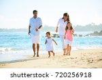 happy family enjoying walk on... | Shutterstock . vector #720256918