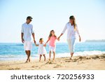 happy family enjoying walk on... | Shutterstock . vector #720256933