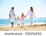 happy family enjoying walk on... | Shutterstock . vector #720256933