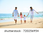 happy family enjoying walk on... | Shutterstock . vector #720256954