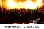 cheering crowd at a rock concert | Shutterstock . vector #720266128