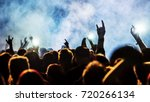 cheering crowd at a rock concert | Shutterstock . vector #720266134