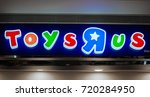 """Small photo of KUALA LUMPUR, MALAYSIA - SEPTEMBER 23, 2017: Toys """"R"""" Us logo. It is an American toy and juvenile-products retailer founded in 1948 and headquartered in Wayne, New Jersey."""