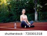 beautiful fitness athlete woman ...   Shutterstock . vector #720301318