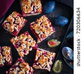 Small photo of Cake with caramelized plums and scab, square