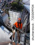 Small photo of Abseiler abseiling from height at Sydney building, Australia.