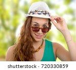 a beautiful portrait of fashion ... | Shutterstock . vector #720330859