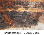 Small photo of dry rot on old wood beam after water infiltration in building ( Serpula lacrimans )